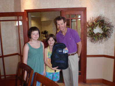 Dunedin FL Dentist Dr. Pitts finds 2 young ladies a backpack
