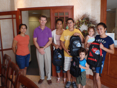 Dunedin FL Dentist Dr. Pitts has backpacks for the whole family